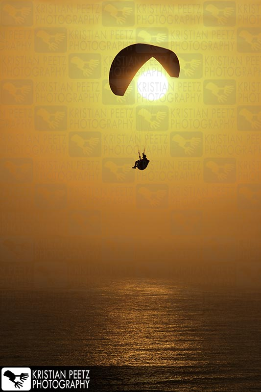 "Paraglider infront of the sun ""Freedom"" - Copyright by Kristian Peetz"